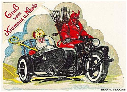 Крампус катает Санта Клауса на мотоцикле